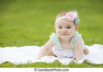 Japanese American Toddler Girl smiling outside