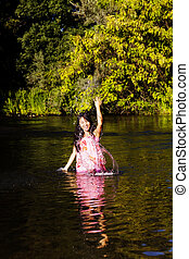 Japanese American Woman In River Splashing Water