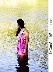 Japanese American Woman Standing In River Wearing Dress