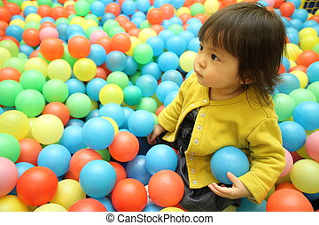 Japanese baby girl in ball pool