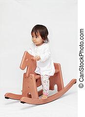 Japanese baby girl on rocking horse