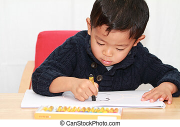 Japanese boy drawing a picture