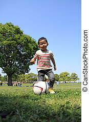 Japanese boy kicking a soccer ball (3 years old)