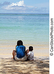 Japanese boy on the beach with his mother