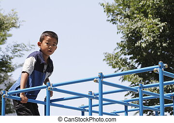 Japanese boy on the jungle gym (second grade at elementary...