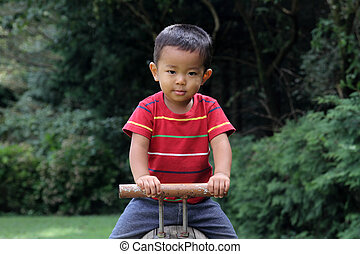 Japanese boy on the seesaw (2 years old)