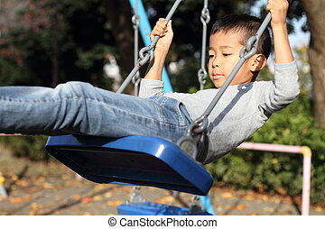 Japanese boy on the swing (first grade at elementary school)