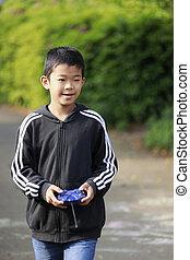 Japanese boy operationg radio control (fifth grade at ...