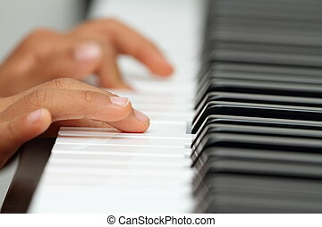Japanese boy playing a piano