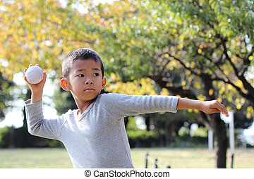 Japanese boy playing catch (first grade at elementary...