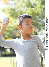 Japanese boy playing catch (first grade at elementary school)