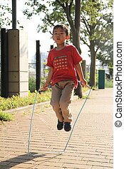 Japanese boy playing with the jumping rope (5 years old)