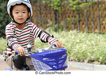 Japanese boy riding on the bicycle (5 years old)