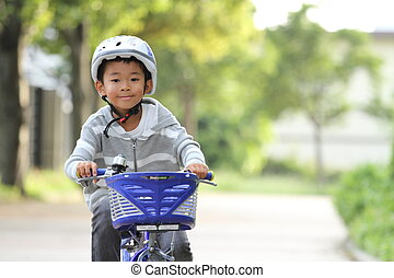 Japanese boy riding on the bicycle (first grade at...