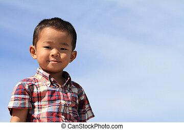 Japanese boy under the blue sky