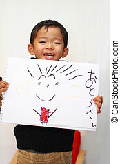 Japanese boy with father's portrait
