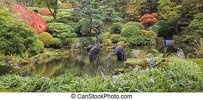 Japanese Bronze Cranes Sculpture by Pond