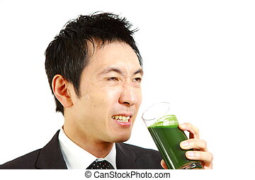 green vegetable juice - Japanese businessman drinks green...