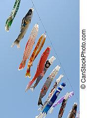 Japanese carp kite decoration against blue sky