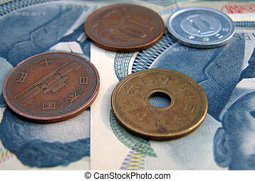 some japanese coins and 1000 yen bills.
