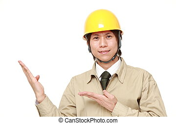 Japanese construction worker presenting