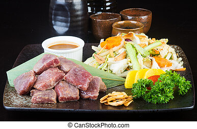 japanese cuisine. beef cube on the background - japanese...
