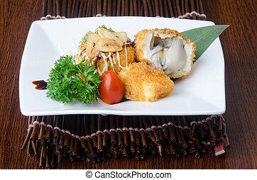 japanese cuisine. fried tofu on the background - japanese...