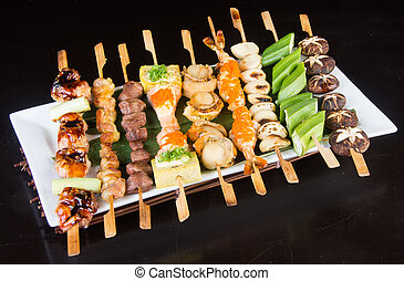 japanese cuisine. grill stick on the background - japanese...