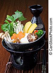japanese cuisine. hot pot on the background - japanese...