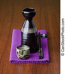 japanese cuisine. sake on the background - japanese cuisine...