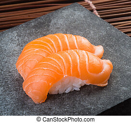 japanese cuisine. sushi salmon on background