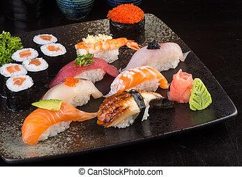 japanese cuisine. sushi set on the background
