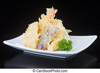 japanese cuisine. tempura seafood on the background