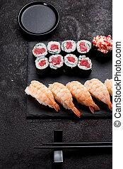 Japanese cuisine. Tuna maki and shrimp sushi on a stone ...