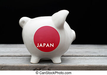 Japanese economy concept with a piggy bank painted with Japan fl