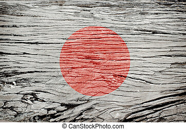 japanese flag on wood texture background