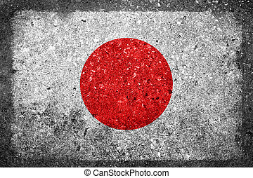 Flag of Japan painted on a grunge wall.