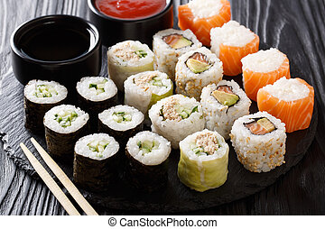Japanese food: a menu of rolls with seafood close-up with sauces. horizontal