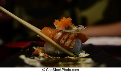 Japanese food in set different types of sushi with seaweed...