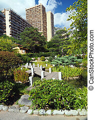 Japanese Garden walkway path in Monte Carlo Monaco Europe condominium in background