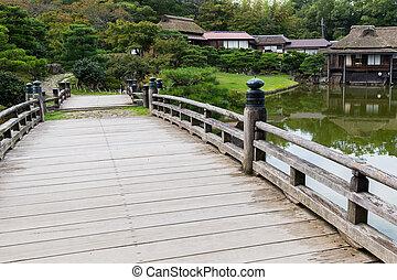 Japanese garden with wooden bridge