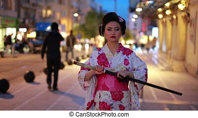 Japanese geisha with sword