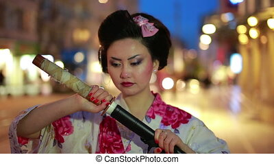 Japanese geisha with sword