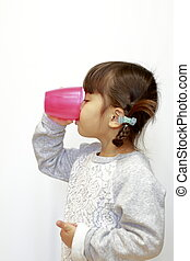Japanese girl drinking water (4 years old)