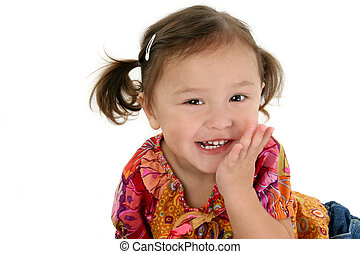 Close-up of two year old Japanese American toddler girl laughing.