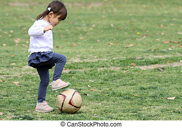 Japanese girl playing with soccer ball (3 years old)