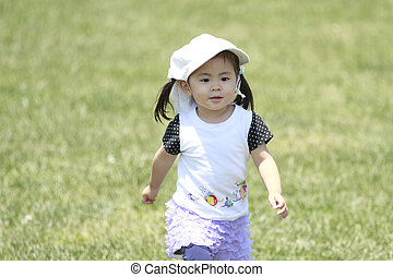 Japanese girl running on the grass (2 years old)
