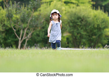 Japanese girl walking on the grass (2 years old)
