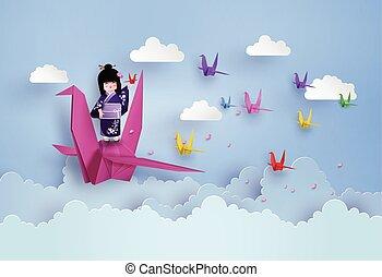 Japanese girls wearing national dress and origami bird...