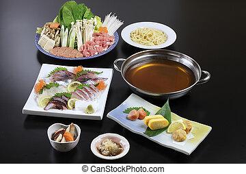 Japanese hot pot of sushi, beef, pork, mushroom, tofu, noodle and cabbage